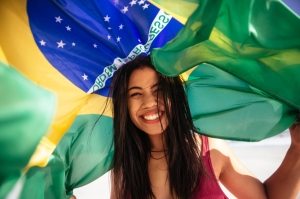 Cheering woman under brazilian flag